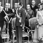22, 1975 shows Juan Carlos of Bourbon taking the oath in front of the Spanish Parliament, the Cortes, and the Kingdom's Council in Madrid, next top his wife Queen Sofia. Spanish King Juan Carlos will abdicate in favour of his son Prince Felipe, the natio