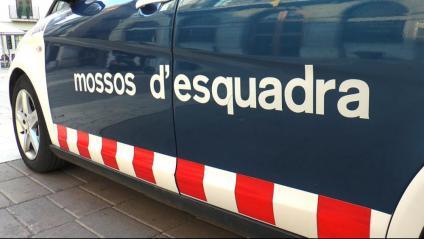 Detall d'un vehicle dels Mossos