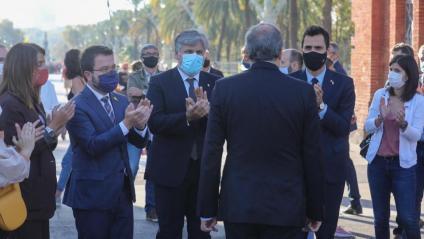El president de la Generalitat, Quim Torra, al passeig Lluís Companys, acompanyat d'altres autoritats, abans d'entrar al TSJC