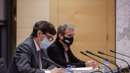 El ministre de Sanitat, Salvador Illa, i el director del CCAES, Fernando Simón, durant una reunió de seguiment de la Covid-19 amb la Comunitat de Madrid
