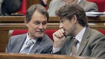 El futur president de la Generalitat, Artur Mas, i Oriol Pujol, president del grup de CiU, en un ple del Parlament, el juliol passat JOSEP LOSADA