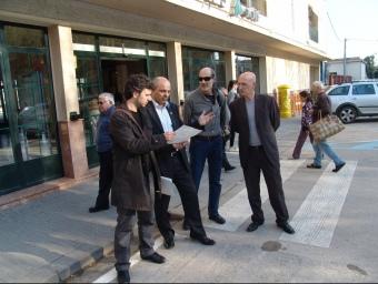 Montfort (esquerra), Boada, Cusí i Elelman, ahir a l'estació del centre de Figueres. J.P