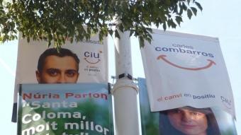 Cartells del PSC i de CiU que durant la campanya han penjat als carrers de Santa Coloma. I.M