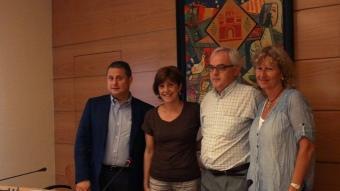 Antonio Báez i Del Frago (PSC), Ramon i Teresa Colomer (CiU), ahir, presentant el pacte E.A