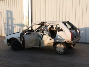 El cotxe que conduïa la víctima, després de l'accident. ACN