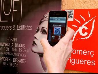 Un comerç de Figueres, que s'acaba d'estrenar com a municipi turístic.  MANEL LLADÓ