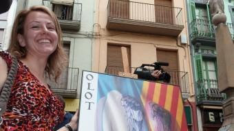 Rita Martorell i el cartell.  J.C