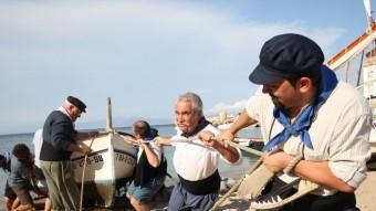 El poble de l'Escala rememora un dia de la vida quotidiana d'ara fa més de cent anys, a l'antic port.  LLUÍS SERRAT