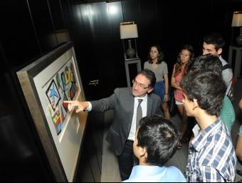 Jaume Giró, director general adjunt de CaixaBank, amb els participants en el projecte Leading Program.  ARXIU