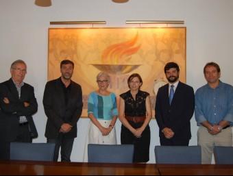 El president de la UFEC, Gerard Esteva, i altres membres de l'entitat amb Carme Forcadell (ANC) i Muriel Casals (Òmnium) UFEC