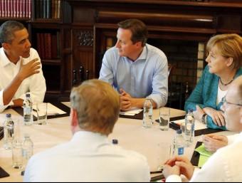 Barack Obama, David Cameron i Angela Merkel en una reunió el 2013 sobre el TTIP.  REUTERS