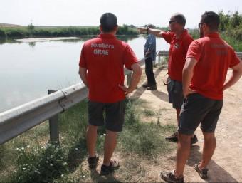 Imatge dels efectius dels GRAE que participen en la recerca del desaparegut, a la zona de les comportes del pantà d'Utxesa ACN