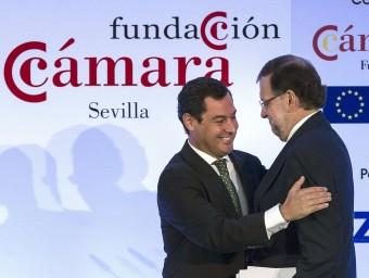 Rajoy i el president del PP andalús, ahir a Sevilla. EFE