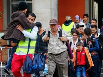 Refugiats a l'estació de tren de Munic REUTERS