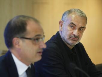 El director general d'immigració, Xavier Bosch, i el coordinador del comitè d'acollida de refugiats, Àngel Miret ORIOL DURAN