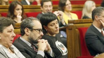 Diputats de la CUP , en el seu escó del Parlament de Catalunya.