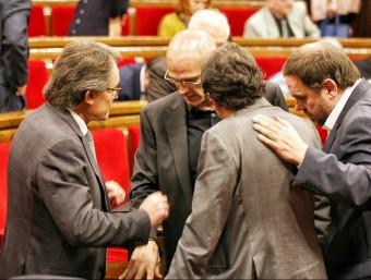 Artur Mas, amb Raül Romeva, Josep Rull i Oriol Junqueras, al Parlament ANDREU PUIG