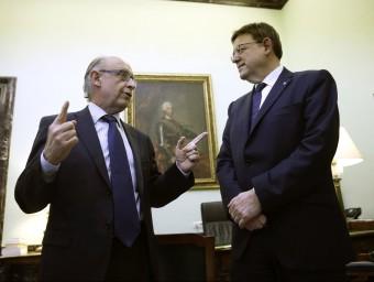 El president de la Generalitat amb el ministre d'Hisenda. AGÈNCIES