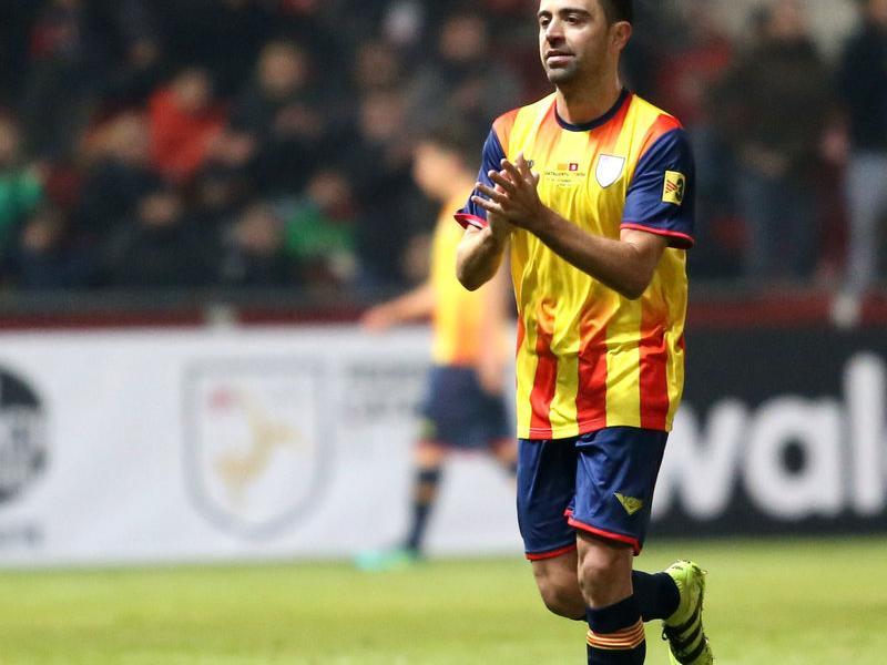 Xavi Hernández en el moment d'abandonar el terreny de joc per ser substituït QUIM PUIG