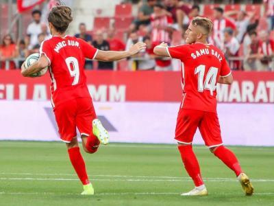Marc Gual i Samu Saiz celebrant el gol de l'empat de Borja García contra l'Sporting