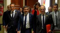 Josep Rull, Jordi Sànchez i Jordi Turull als passadissos del Congrés el 20 de maig