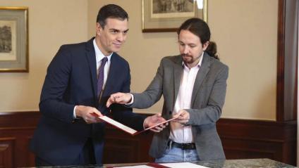 Sánchez i Iglesias, en el moment de signar l'acord