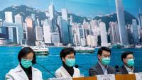 #La cap del govern de Hong Kong, Carrie Lam, amb màscara pel virus, anunciant el tancament de la frontera terrestre
