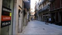 Zona de l'Argenteria de Girona amb botigues tancades
