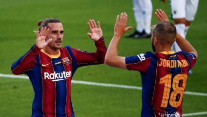 Griezmann i Jordi Alba celebren l'únic gol del partit