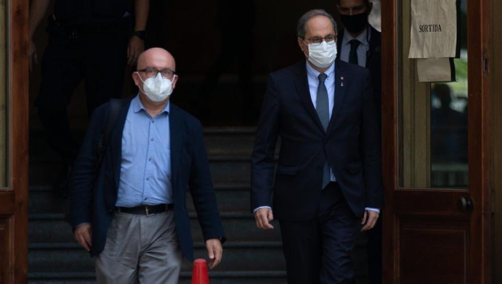 El president de la Generalitat, Quim Torra, amb el seu advocat Gonzalo Boye, sortint aquest dimecres del Tribunal Superior de Justícia de Catalunya que investiga la seva segona causa per desobediència