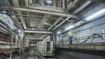 Les obres de la primera fase de l'accés ferroviari a l'aeroport de Barcelona van consistir en la perforació del túnel