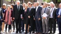 L'expresident Puigdemont , amb l'exconseller Romeva i l'exsecretari general de Diplocat, amb convidats internacionals per l'1-O del 2017
