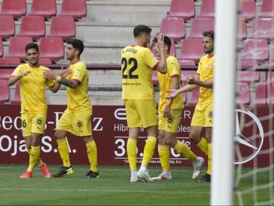 Stuani i Bueno celebren un dels gols del davanter contra el Logroñés