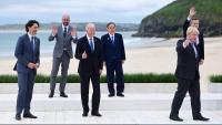 Líders del G7 saluden a les càmeres durant la sessió d'ahir de la cimera a Carbis Bay, a Anglaterra