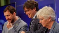 El tres eurodiputats de Junts a l'exili, Comín, Puigdemont i Ponsatí, durant una roda de premsa al Parlament Europeu el passat 3 de juny