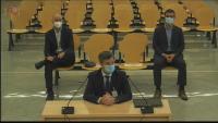 Els dos agents dels Mossos escolten el testimoni d'un cap de la policia espanyola en el judici a l'Audiencia Nacional, el 7 de juliol passat