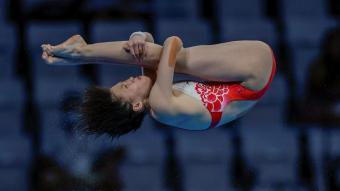 hongchan Quan en un dels seus salts de la final