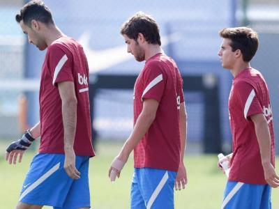Sergi Roberto, amb Riqui Puig i Sergio Busquets