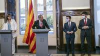 El president Torra entre els presidents Borràs i Aragonès i el vicepresident Puigneró ahir al Parlament